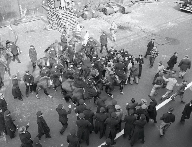 Mounted New York City police officers battle with striking members of the International Longshoremen...