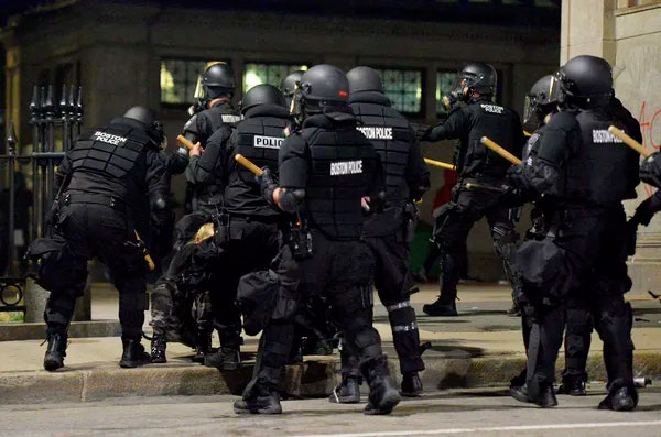 Police surround a protester in Boston, Massachusetts on May 31, 2020.