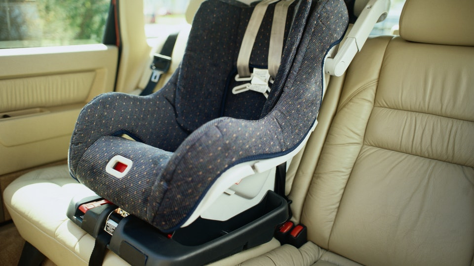 empty baby car seat in the back seat of a car