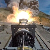 NASA fires up rocket booster in crucial test before human flight to Moon