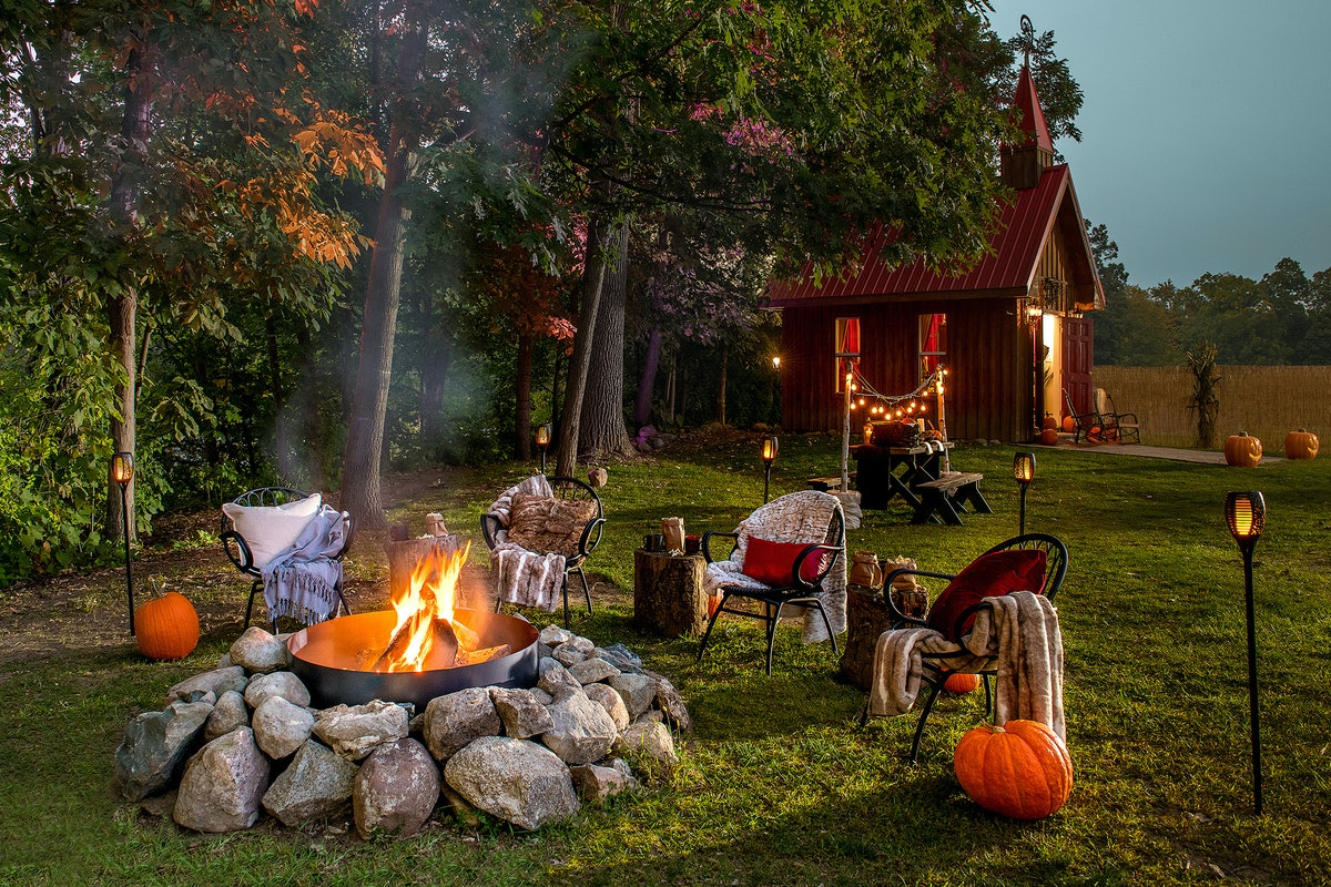 """The """"Mayor of Hell"""" listing on Airbnb includes a spooky tiny house in Hell, Michigan complete with a fire pit and picnic table."""
