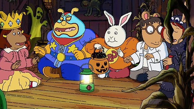 Still from 'Arthur and the Haunted Tree House'; kids sitting in a tree house in their Halloween costumes