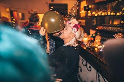 Young couple kissing on Halloween