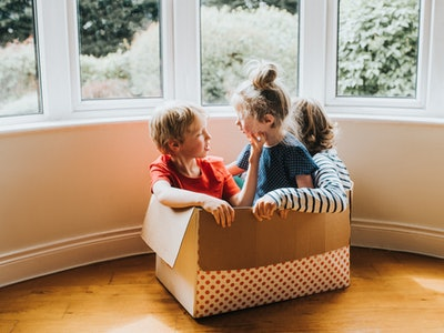 Siblings playing in an empty box: kids share what they loved about quarantine during the coronavirus pandemic