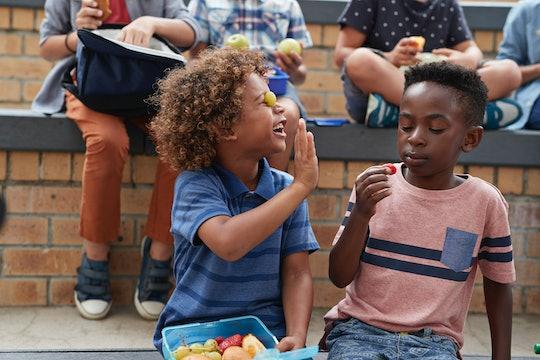 pre-k kids eating lunch outside
