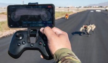 Airman controls a Vision 60 robot on patrol.