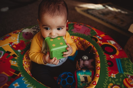 a baby in an exersaucer