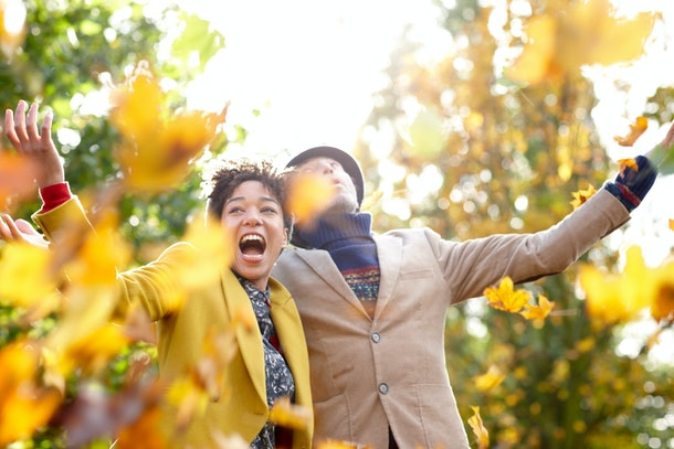 Young couple in fall leaves