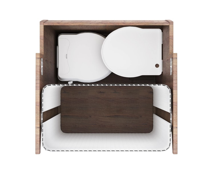A removable toilet seat can be seen in white color. It is compact and surrounded by what appears to be dark wood.
