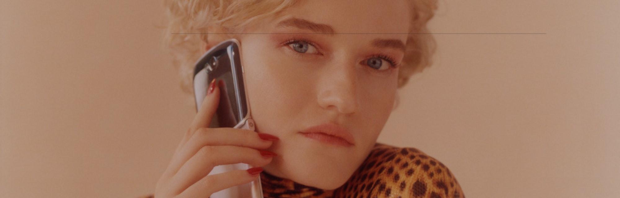 Actress Julia Garner holding the Motorola Razr.