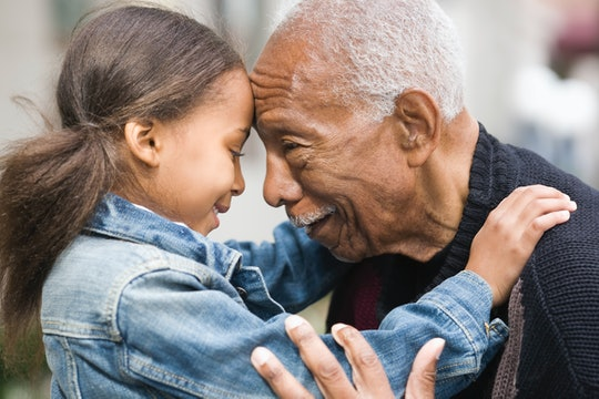 young girl and grandfather forehead to forehead