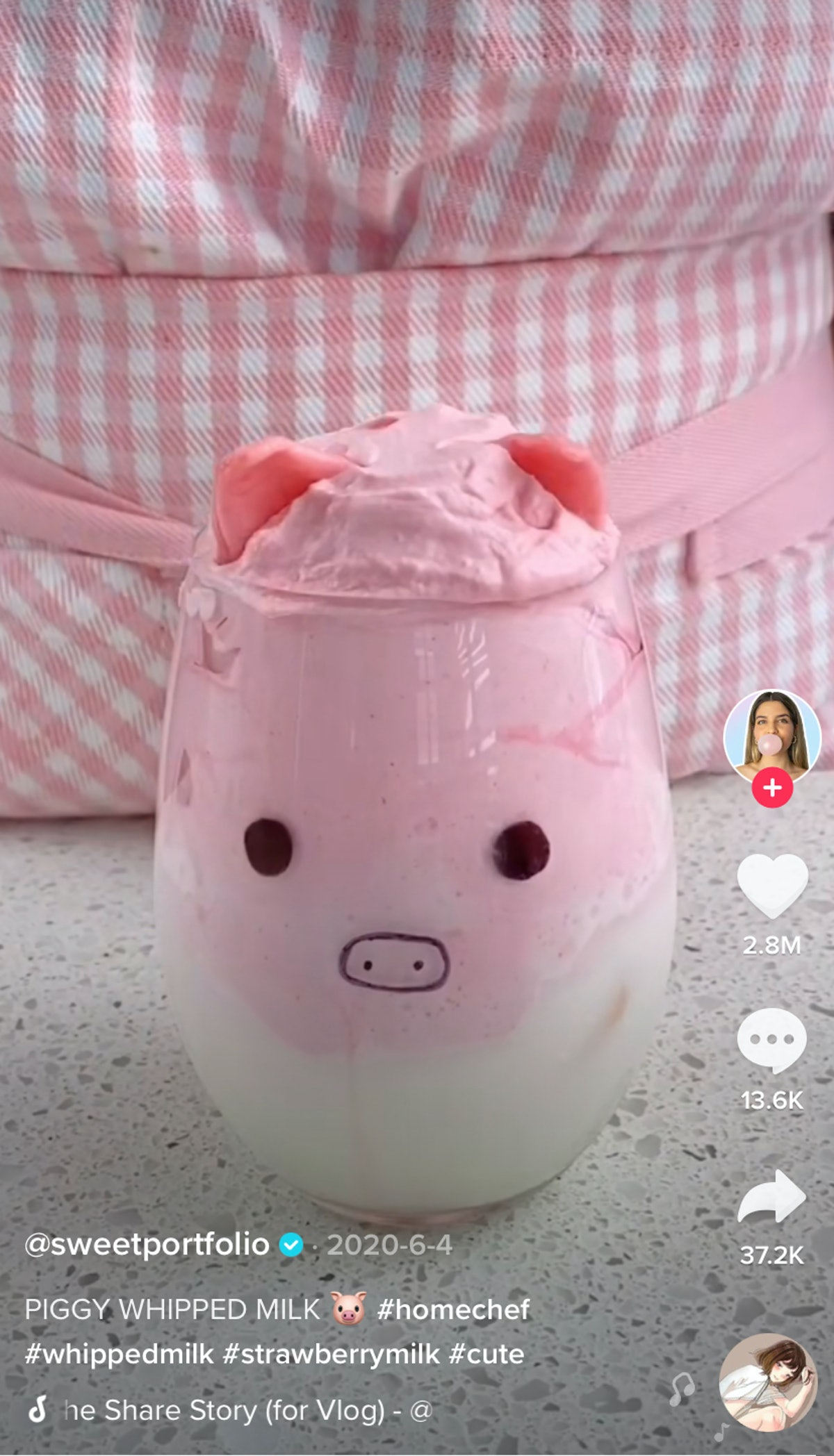 A woman makes a pink pig latte for TikTok.