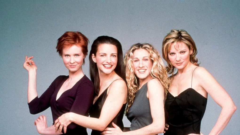 """Sex and the City"" cover photo including Cynthia Nixon, Kristin Davis, Sarah Jessica Parker, and Kim Cattrall."