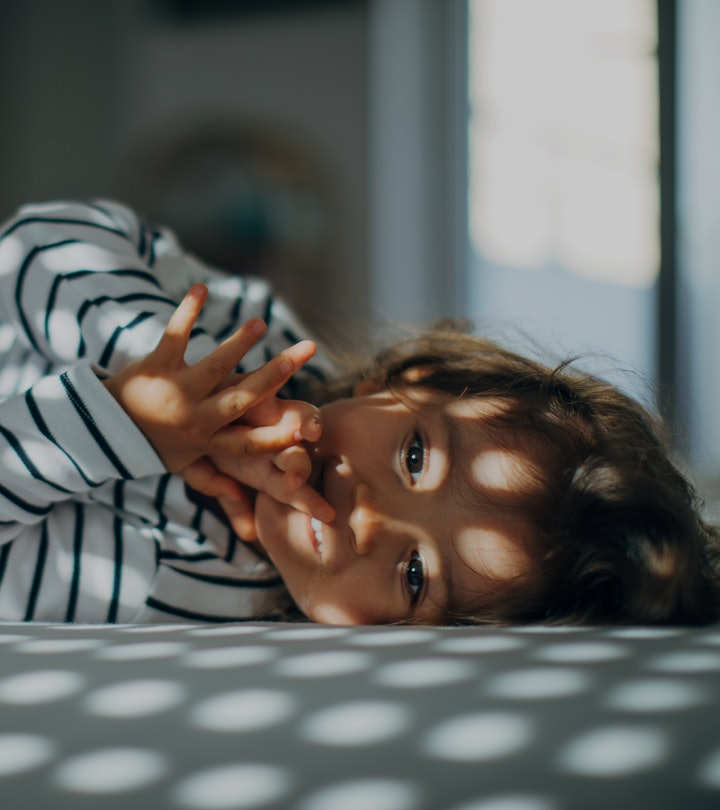 young child lying down in bed