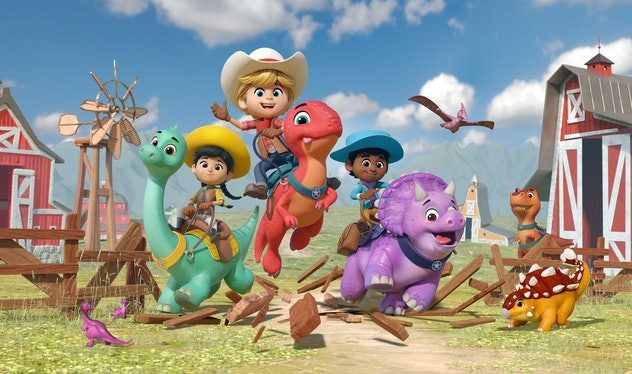 Children dressed as cowboys and cowgirls ride on the backs of colorful, friendly, cartoon dinosaurs.