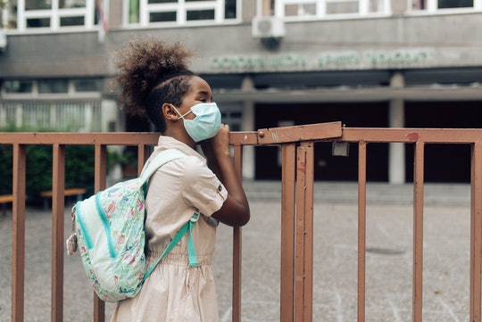 girl with face mask outside school