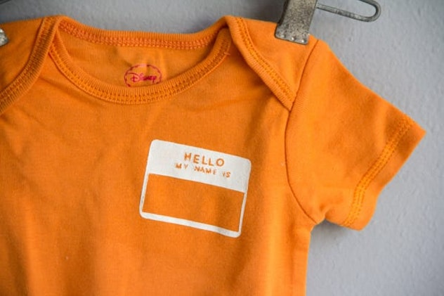 onesie with name tag stenciled on