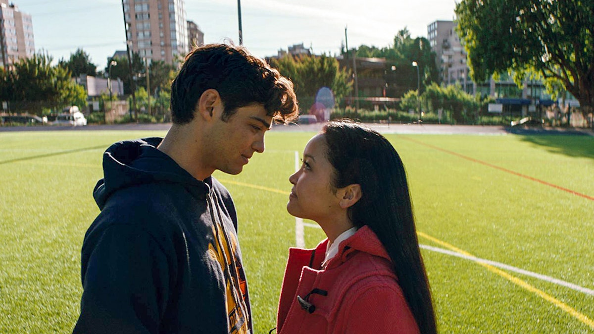 Peter and Lara from 'To All the Boys I've Loved Before' stare into each other's eyes on a soccer field.