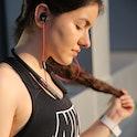 A woman wearing Finalace headphones