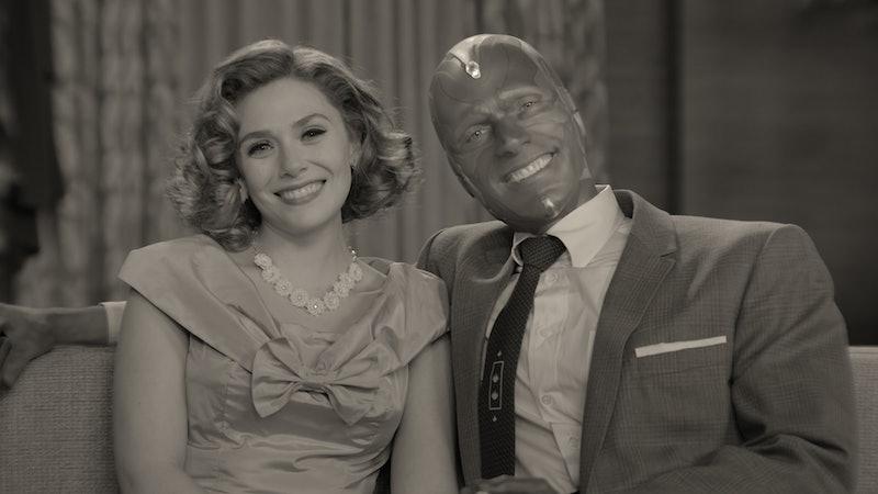 Wanda and Vision smiling into the camera on 'Wandavision' via the Disney+ press site