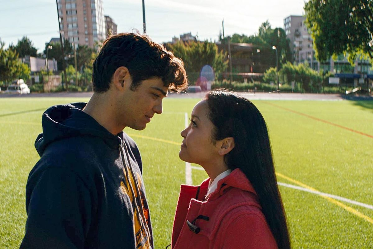 Lara Jean and Peter Kavinsky look at each other on a lacrosse field in 'To All The Boys I've Loved B...