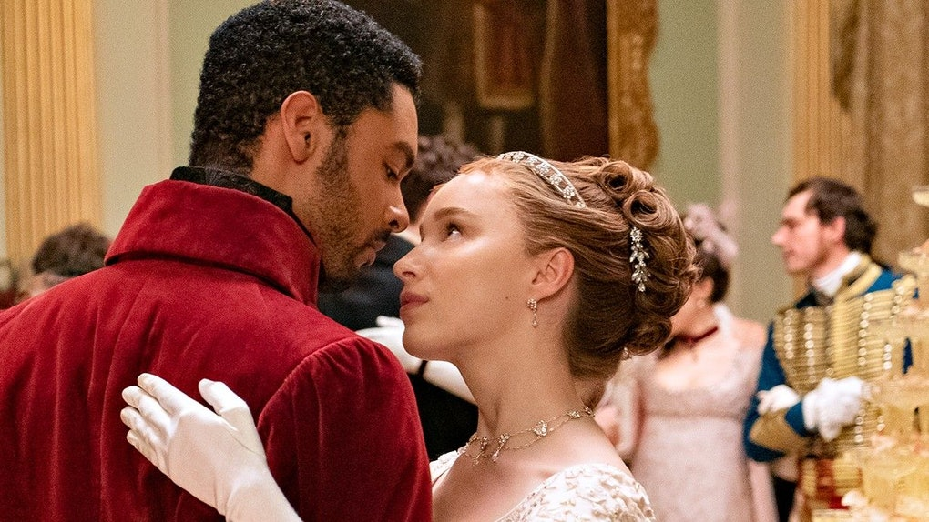 Simon and Daphne dance together at a ball in 'Bridgerton.'