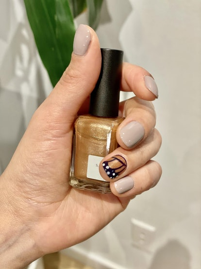 This butterfly nail art features an easy and simple accent nail.