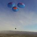 The Blue Origin NS-14 capsule landing, aided by a parachute.