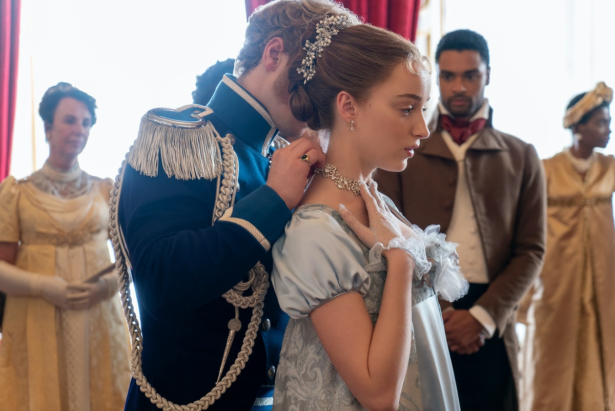 """The prince gifts Daphne a jeweled necklace at a ball in """"Bridgerton."""""""