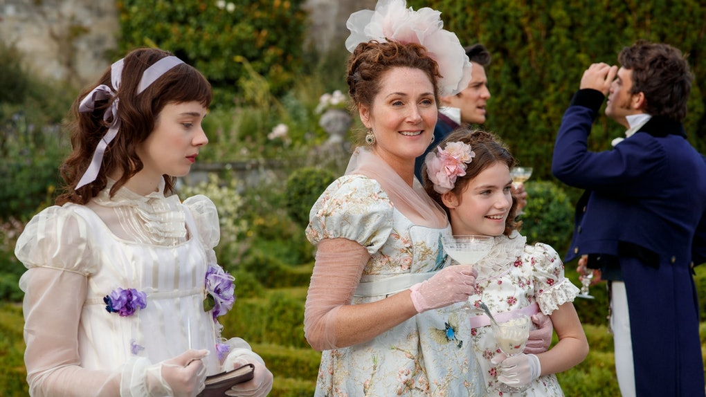 Lady Violet Bridgerton walks in the garden with her daughters, Eloise and Hyacinth, in 'Bridgerton.'