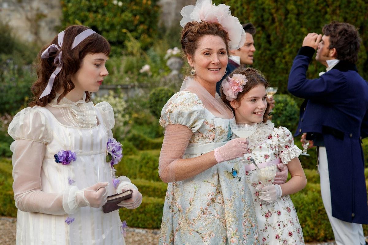 Lady Violet Bridgerton walks in the garden with her daughters, Eloise and Hyacinth, in 'Bridgerton.'
