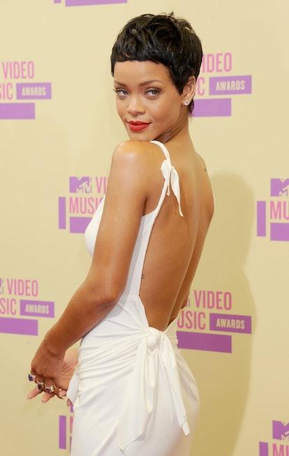 Rihanna showcases the pixie cut on curly hair.