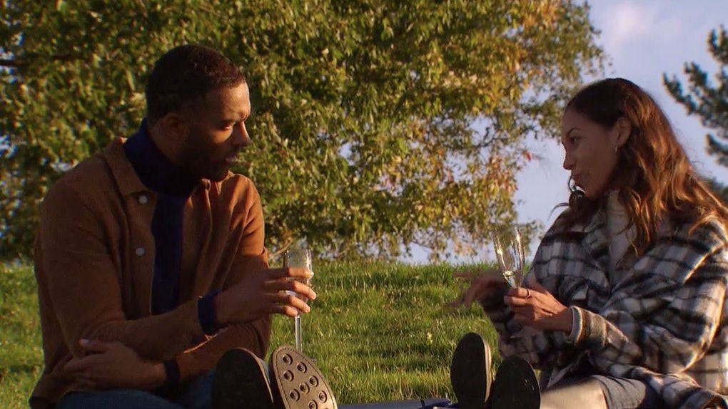 'The Bachelor's Matt James and Serena chat while holding champagne glasses and enjoy a charcuterie board on their picnic date.