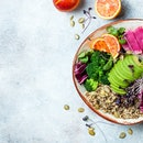 Vegan, detox Buddha bowl with quinoa, micro greens, avocado, blood orange, broccoli, watermelon radish, alfalfa seed sprouts.