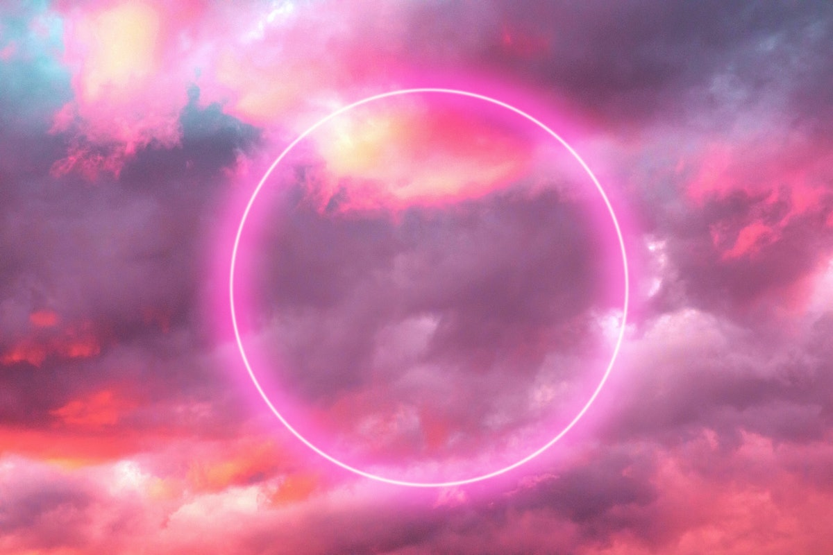 Futuristic neon circle in the burning sky with stunning pink colors