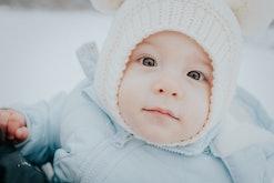 close up of bundled up baby