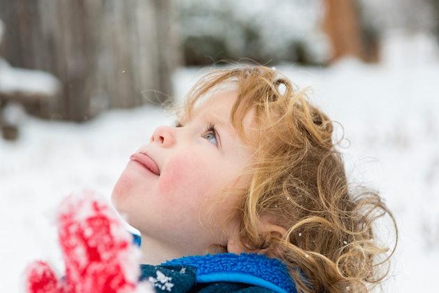 toddler licking falling snow