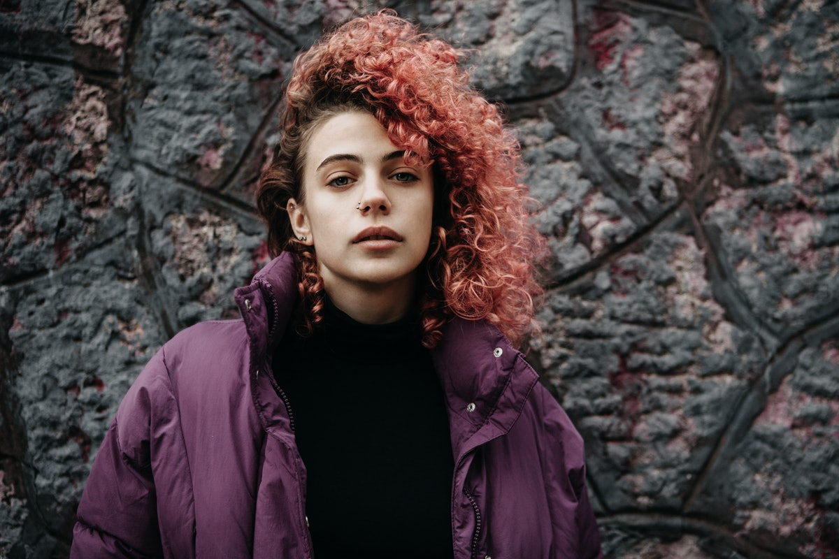 Young woman with pink curly hair
