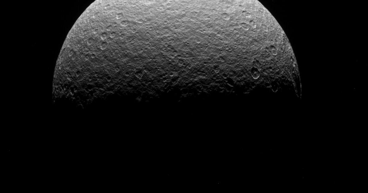 Saturn's moon Rhea has a mysterious material on its surface