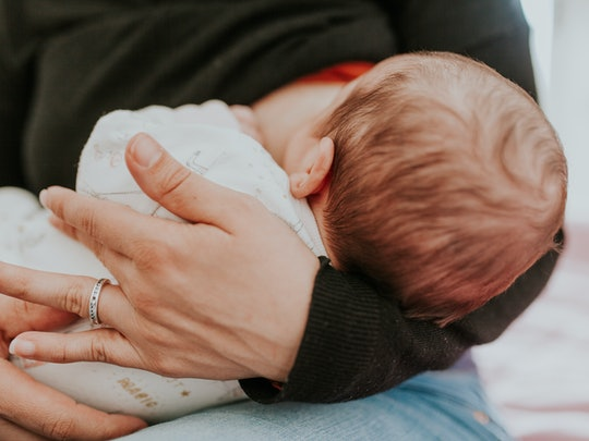 You should continue breastfeeding, even with a clogged milk duct.