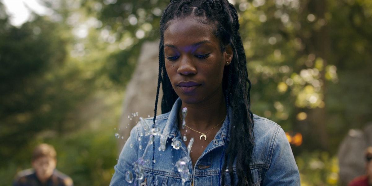 Aisha makes water move in a matching blue denim jacket.
