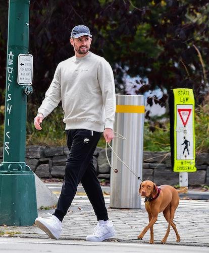 Kevin Love walks his dog.