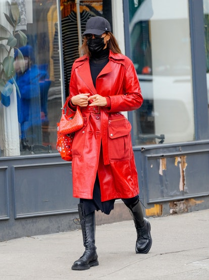 Irina Shayk in a red leather coat from Coach while walking in New York City on Jan. 27.