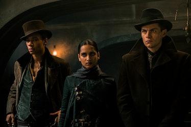 Kit Young as Jesper Fahey,  Amita Suman as Inej Ghafa and Freddy Carter as Kaz Brekker in Shadow & B...
