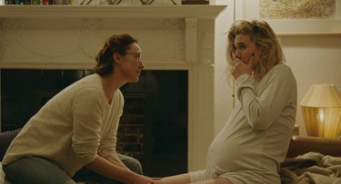 Martha (played by Vanessa Kirby) in labor at her home, looked over by her midwife, Eva