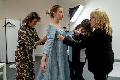Phoebe Dynevor Tries On Daphne's Costume. Photo via Netflix