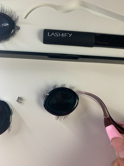 Lifting a Lashify lash extension with application tool.
