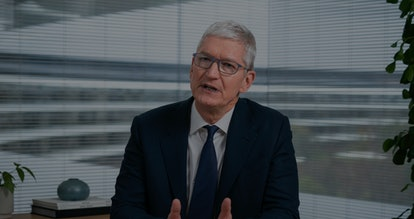 CEO of Apple, Tim Cook, is seen on a smartphone screen while delivering remarks about data privacy.