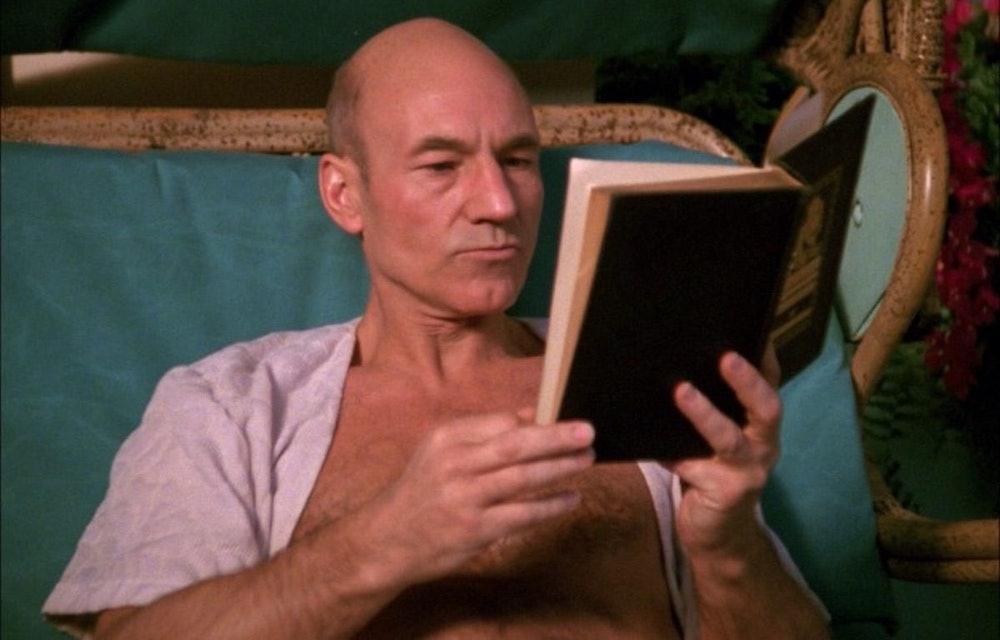 Renaissance man Jean-Luc Picard enjoys a book during a rare moment away from the bridge.