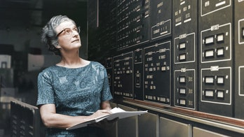 Nancy Grace Roman in front of a computer at NASA, historical image
